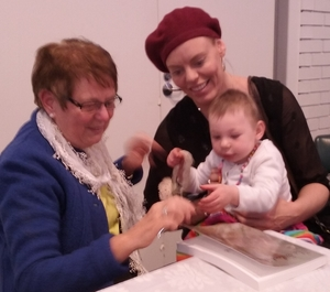 Bernadette signing The Silent Book for her cousin Celeste and baby Etienne at the John Pierce Centre for the Deaf.